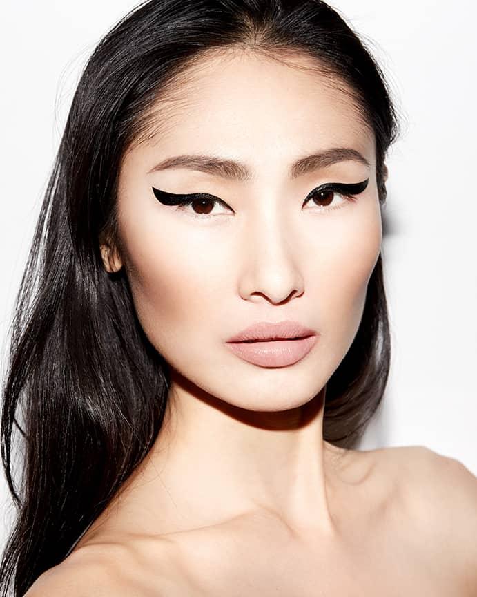 Dinara Chetyrova in a look inspired by Zaha Hadid for Beauty Is Boring by Robin Black.